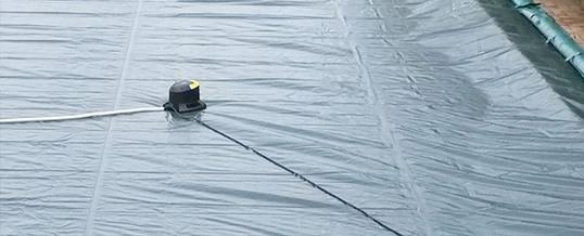 Pompa sommersa per svuotare telo di copertura invernale